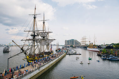 Tall Ships lined up along the waterfront