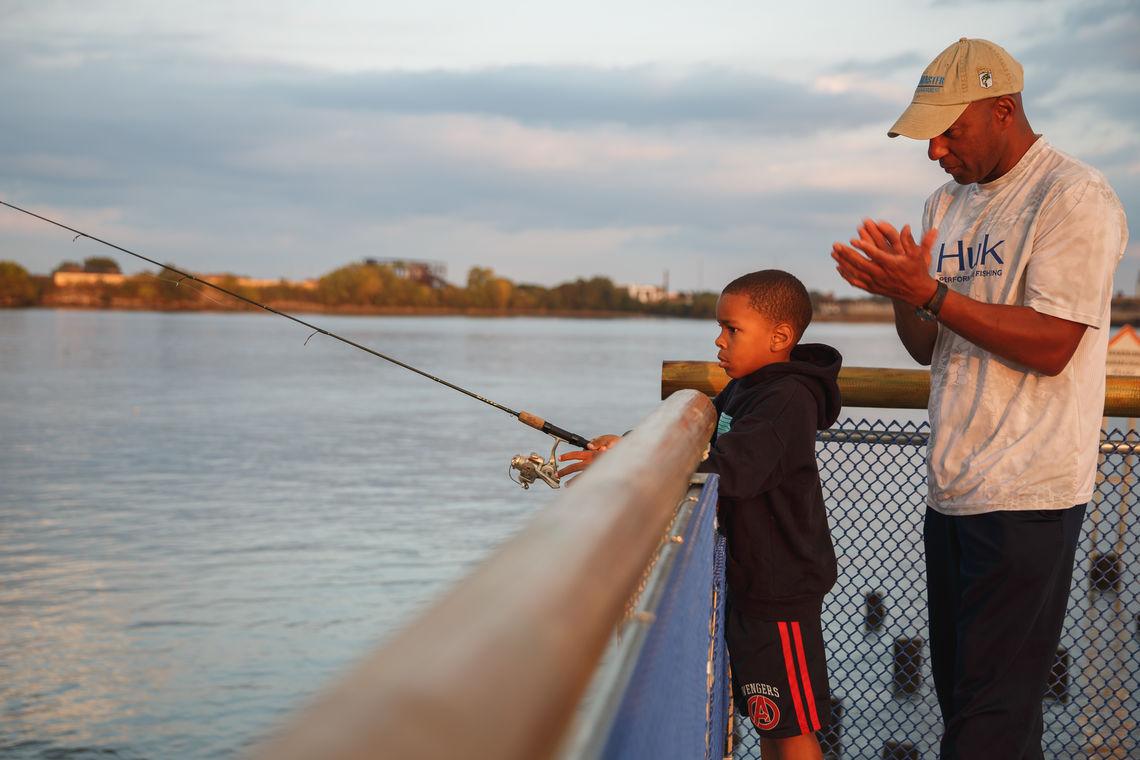 Learning fishing skills at Pier 68