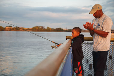 Learning fishing skills at Pier 68