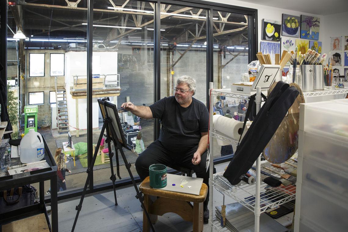 Resident artist Ed Marion at work at Cherry Street Pier